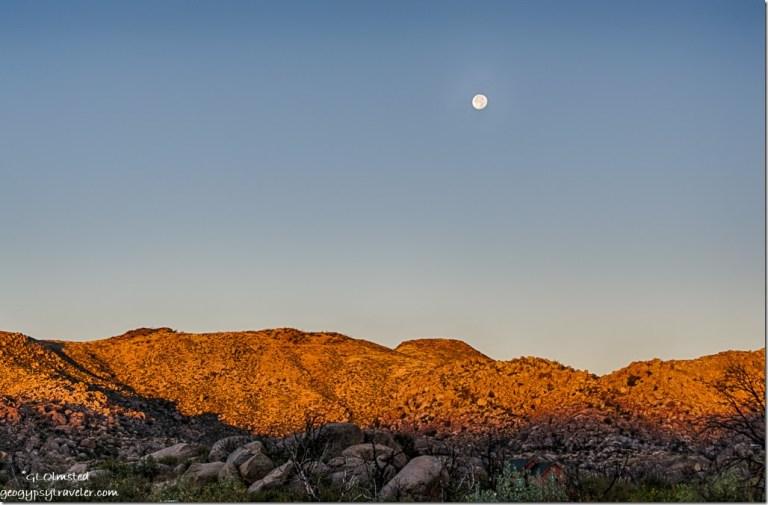 setting full moon morning light Weaver Mountains Yarnell Arizona