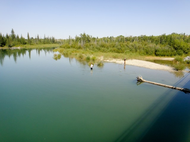City of Calgary Waterworks personnel collect water samples for testing