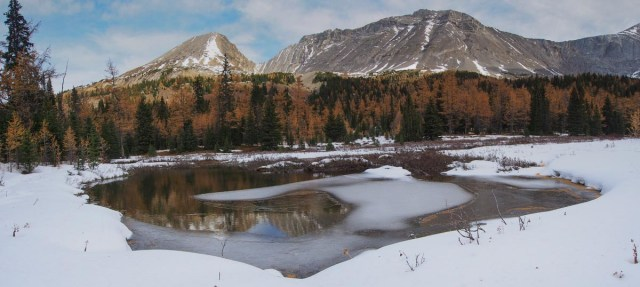 At the end of the short ascent through the woods, the trail opens into a meadow. The pond is already partially covered in ice. This is the view looking towards Little Arethusa (the peak on the left) across the valley.
