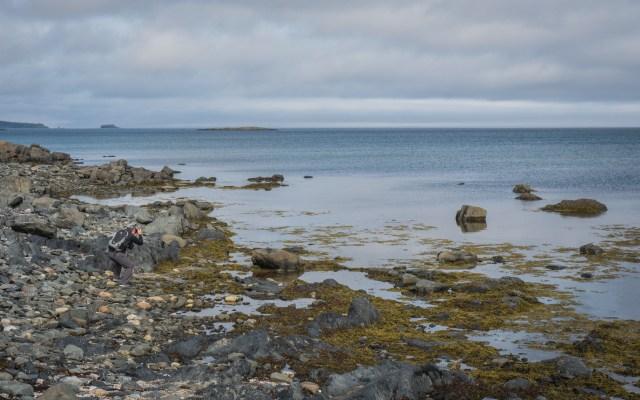 man-photographing-ocean