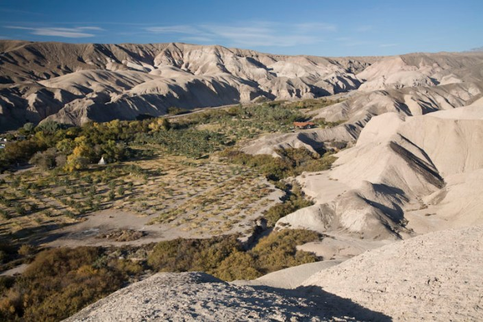 View of eroded lake beds of China Ranch. Just beyond the southern edge of the Amargosa Valley, the Amargosa River cuts a canyon through the Sperry Hills. Here lies China Ranch, an oasis that now hosts a date palm plantation. Surrounding China Ranch are the eroded badlands of the Miocene China Ranch Basin.