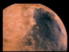 """This image shows Syrtis Major aka the """"Blue Scorpion,"""" which is an exposed basalt region (not covered by red dust)."""