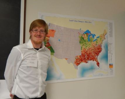 """Andy Bradford and his map, """"Census Changes as a result of Civil War, 1860-1870""""."""