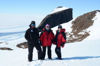 Tebogo, Jenna and Nicola with Cairn Peak in the background