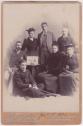 Calderon family photograph, 1 January 1894. Clockwise: seated on floor George Calderon, Jack Calderon, Marge Calderon, Fred Calderon, Alfred Merigon Calderon, Evelyn Calderon, seated next to table Clara Calderon.