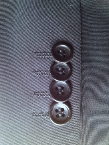 "Standard cosmetic sleeve buttons. These are stacked ""kissing"" buttons, so-called because they actually touch or ""kiss."""