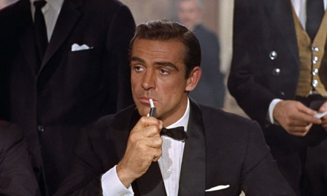 Sean Connery in Dr. No (1962), wearing a custom midnight navy shawl-collar dinner jacket by Anthony Sinclair