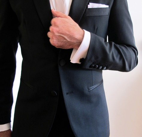 Closeup of dinner jacket with exposed shirt cuff. (The jacket will naturally expose more shirt cuff when you bend your arm.)