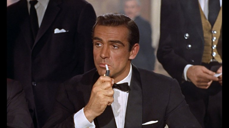 Audience's very first glimpse of Sean Connery as Bond in Dr. No in 1962.