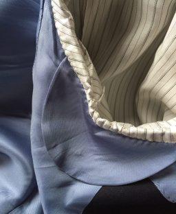 Hand-sewn armhole detail.