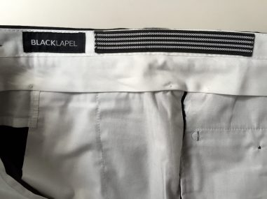 "Rubber ""grip"" strip sewn into the waistband lining."