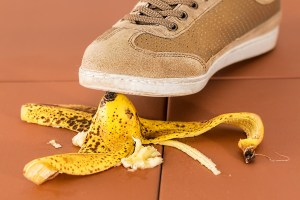 Image of a shoe about to slip on a banana peel. Expect unexpected obstacles.