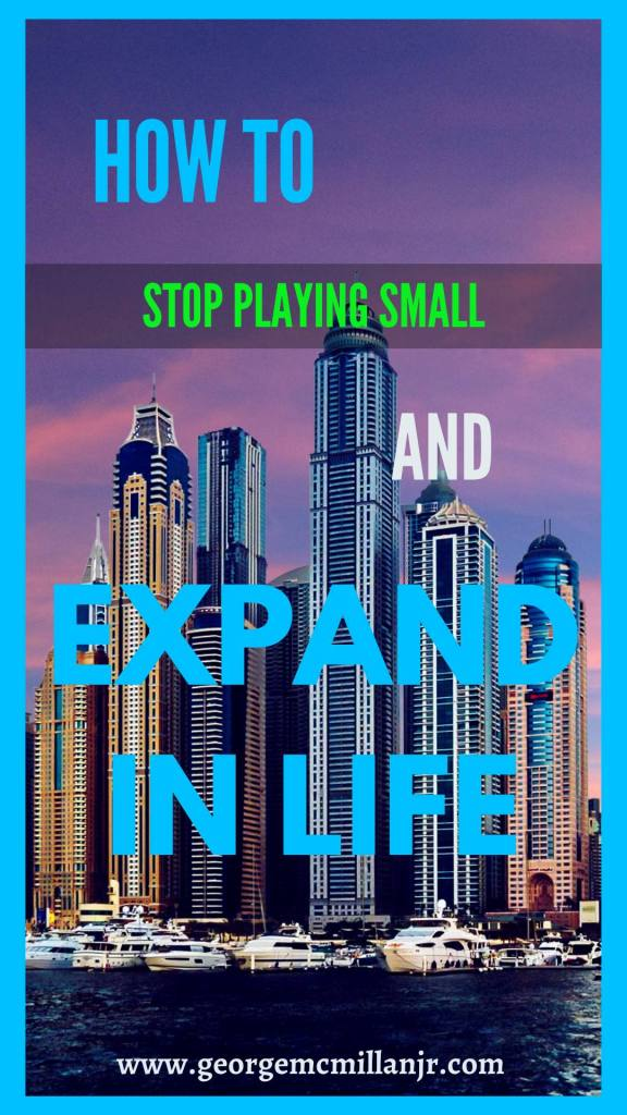 A pinterest image for a blog post of skyscrapers and a purple sky that says How to Stop Playing Small and Expand in Life