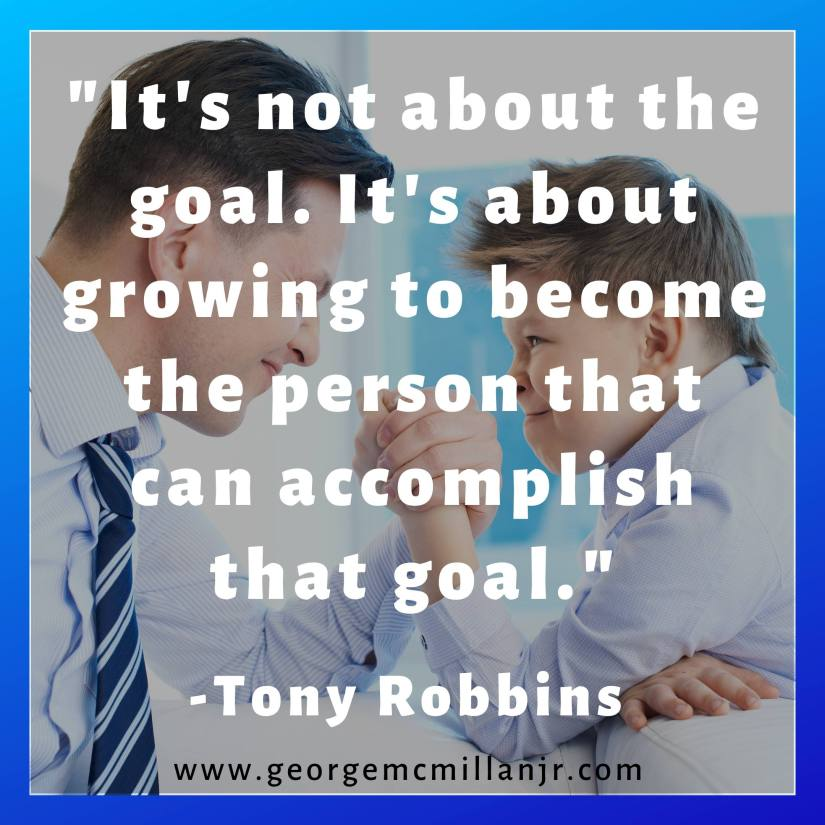 """A picture of a father and son shaking hands, with a Tony Robbins quote that says, """"It's not about the goal. It's about growing to become the person that can accomplish that goal."""""""