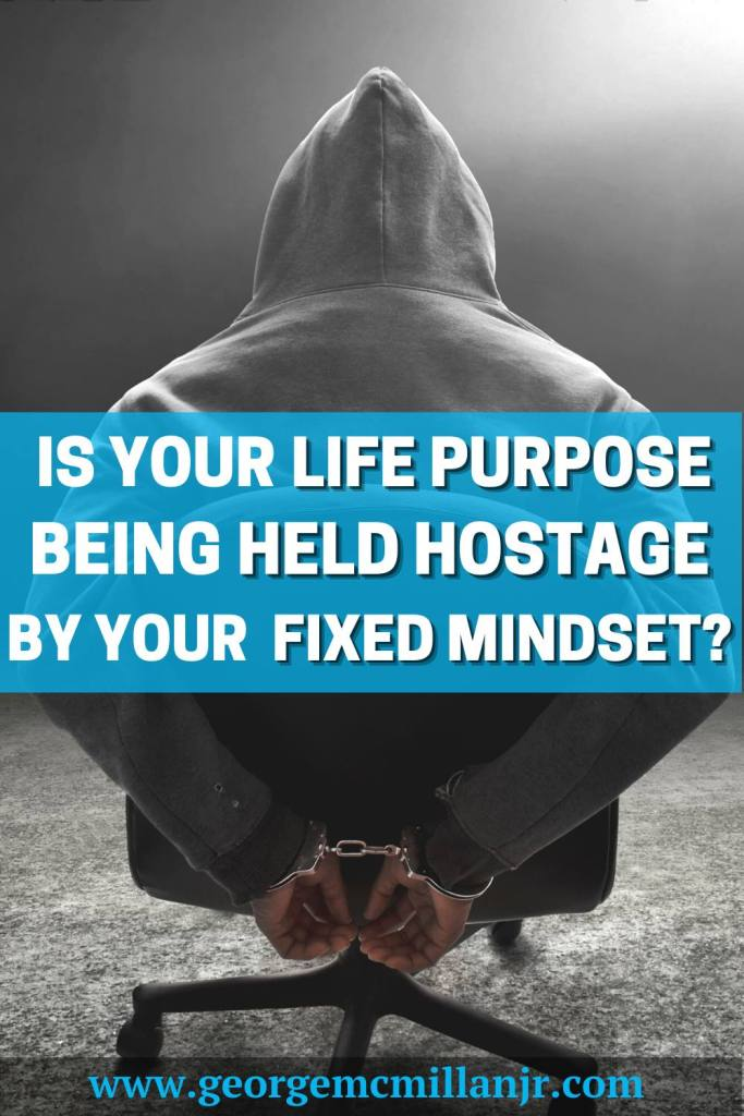 A Pinterest pin image of a man being held hostage with hands tied with the title, Is Your Life Purpose Being Held Hostage By Your Fixed Mindset?