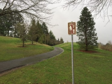 Paved paths meander through the grassy expanse of Gabriel Park.