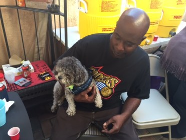Terrell, husband of our niece Bernie, with one of their poodles, Splash. (Who, it should be noted, bit me three times during the visit.)
