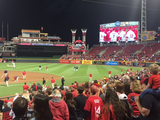 Fans celebrate a Reds' win over the Milwaukee Brewers on May 6, 2016.