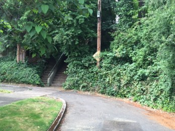 A nearly hidden staircase connects NE 50th Avenue to Wistaria Drive.