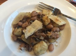 Mushroom-stuffed gnocchi with cannelloni beans.