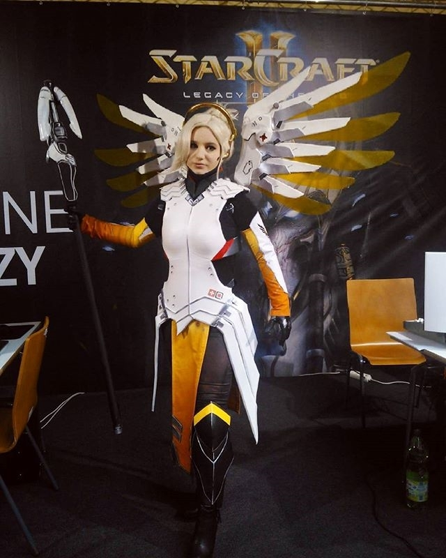 That is some top level cosplay! Regram follow @calypsencosplay Me as Mercy from Overwatch! Cosplay made by me.  I'm at @lgpolska booth at the #esportnow event! Come and say hi 😀 #overwatchcosplay #cosplay #overwatch #blizzard #blizzardcosplay #mercy #mercycosplay #angel #ow #wroclaw #wings #evafoam #cosplaygirl