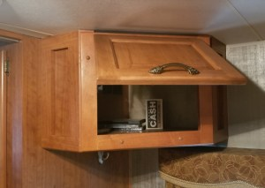 Bedroom TV compartment converted into extra storage space