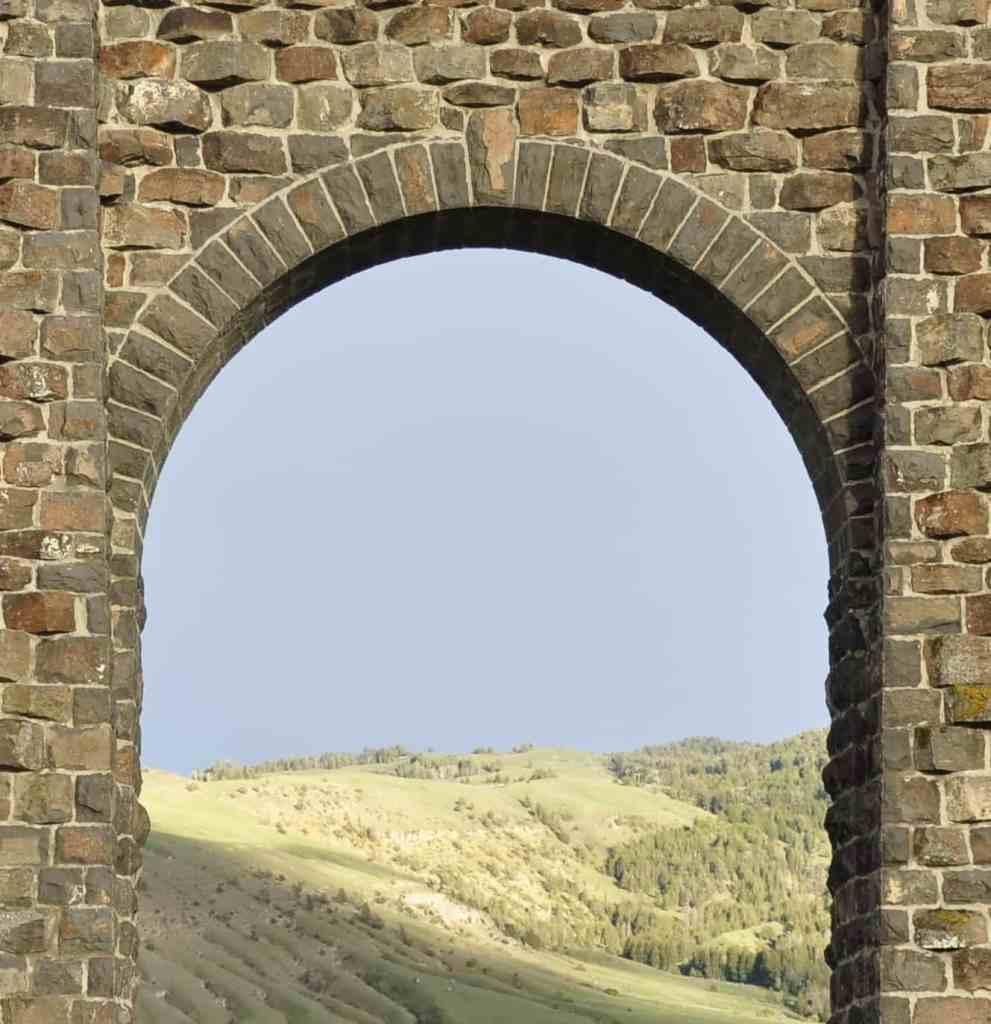 An open stone arch door