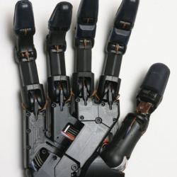 Metal hand with wires coming out