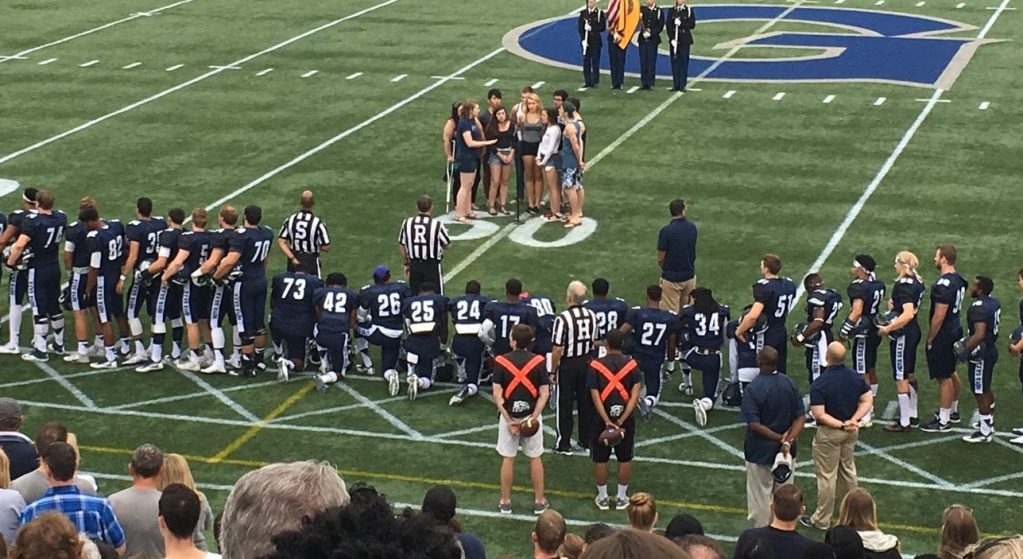 Kneel with GU Football Players and Cheerleaders