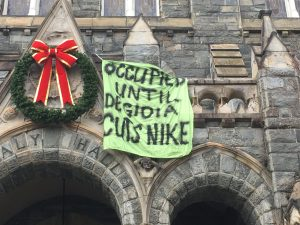Students occupying DeGioia's office dropped a banner from the balcony. Photo: Lilah Burke