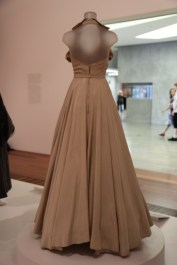 Ball gowns like Peggy's are emblematic of the 1950s prosperity after the two world wars and the depression