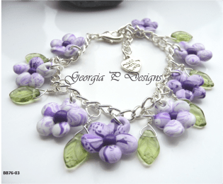 Polymer clay purple & white flower charm bracelet