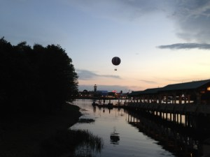 Balloon rising over the lake.