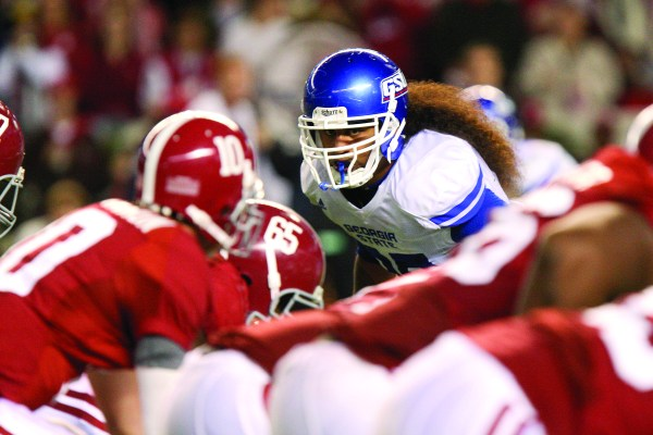 GEORGIA STATE ATHLETICS Panther alum Jake Muasau lines up over the Alabama offensive line.