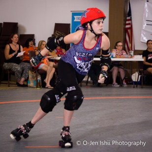 Georgia State student Hale Damage, a jammer, skates on to score a point for her team. Photos Submitted | O-Jen IShii