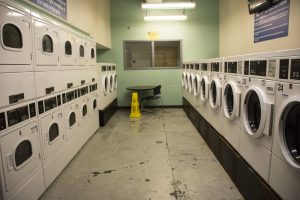 There are 12 washers and 12 dryers in the Georgia State Student Lofts , however students are uneasy with the small amount of machines that are available versus the amount of residents that live there. Photo by Jade Johnson | The Signal