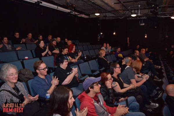 Audience members give an applause to the end of a film being screened at the Buried Alive Film Fest. Photo Courtesy of Buried Alive Film Fest Team
