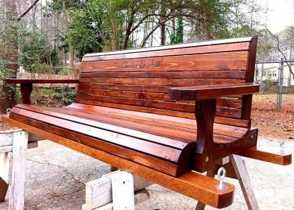 dark brown wooden porch swing