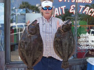 """George of  Brunswick, Ga. caught this nice pair of flounder from the St. Simons Pier last week. The biggest was a 28-inch 8-pounder, while the """"little"""" one was 26 inches and 7 pounds. (Photo courtesy of St. Simons Bait and Tackle)"""