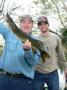 Scout Carter (right) of Blackshear caught his first chain pickerel (jackfish) while fishing on the St. Johns River