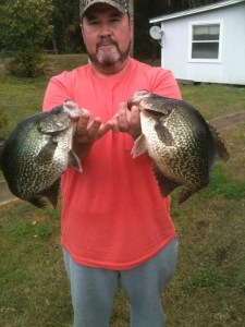 Mike Harrell of Waycross shows a pair of slab crappie that he caught on artificials during the last warm spell.