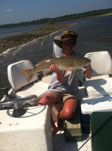 Carli Davidson of Waycross caught this 26-inch redfish in the Brunswick area the week of Memorial Day. Trout and redfish are picking up on the Georgia coast.