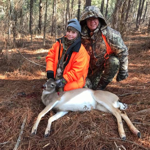 mother and youngin pose with a first deer