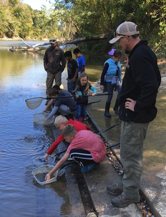 Students from Armuchee Elementary School helped stock Lake Sturgeon on the Oostanaula River