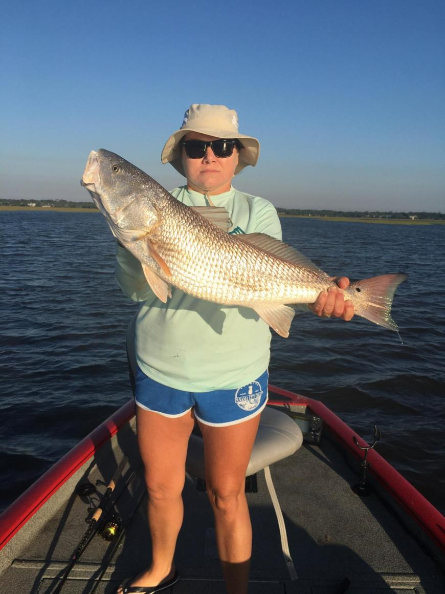 Donna Carter of Alma caught and released this oversized redfish while using dead shrimp on the bottom in the Brunswick area on Tuesday.