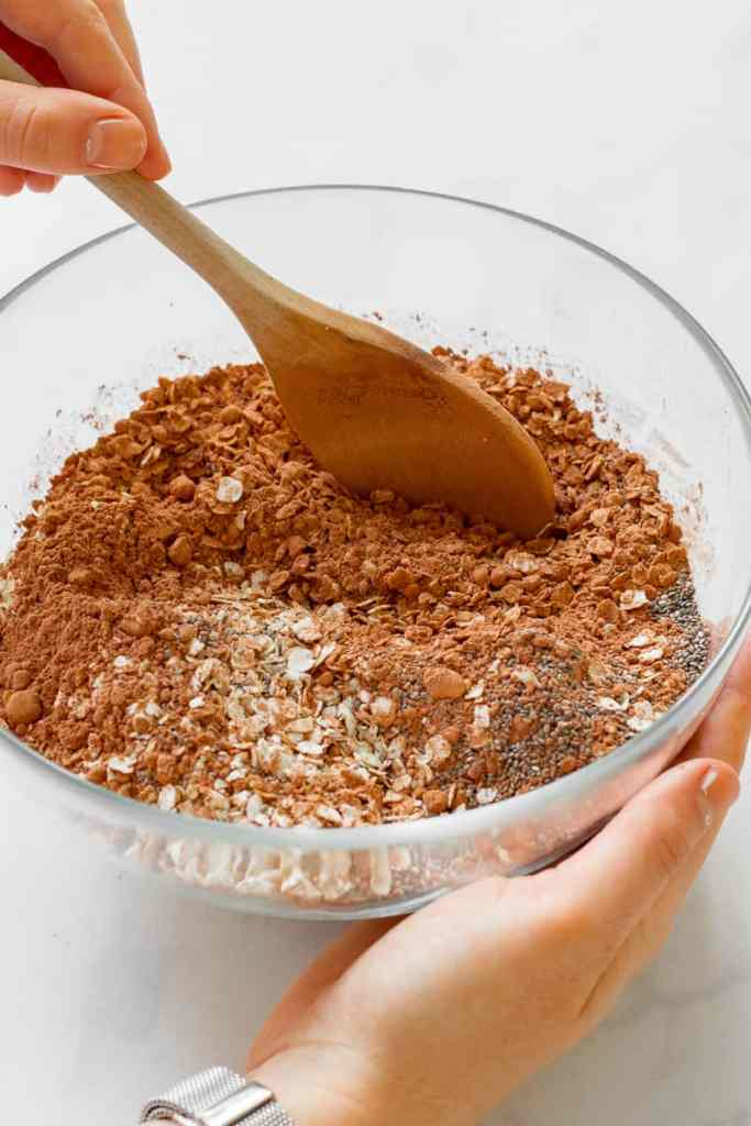 Stirring the dry ingredients together in a bowl.