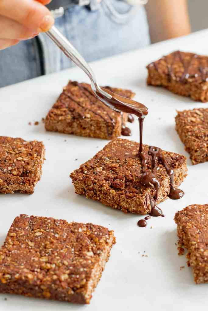 Drizzling melted chocolate over the chocolate flapjacks.
