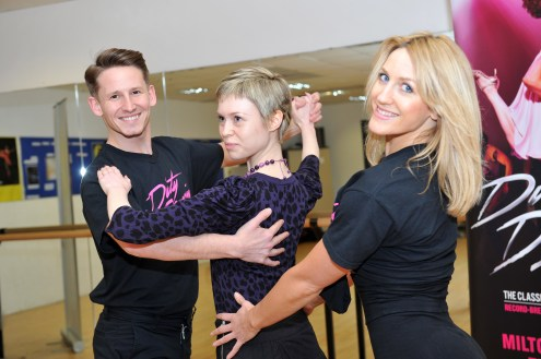 "Dirty Dancing press launch, February 2014. Georgina Butler recreates the Dirty Dancing ""sandwich"" pose with James Bennett and Lisa Welham."