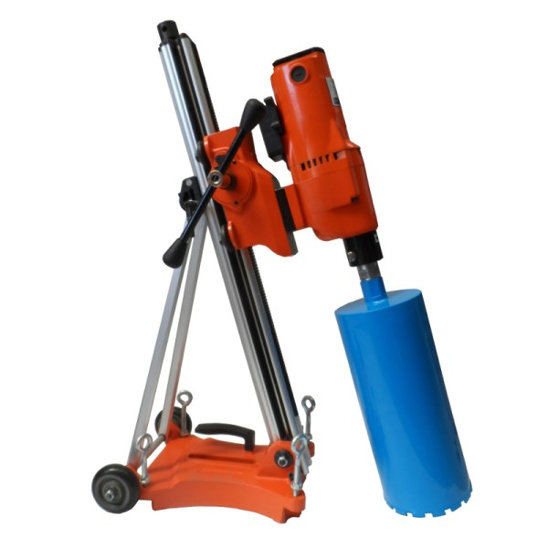 The Portable Core Drill electric powered engine is used for fast drilling into concrete or asphalt surfaces.