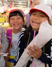 Elementary school students learning how to shop at local market
